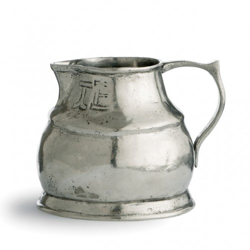 """Each one-of-a-kind pitcher is a marriage of the highest quality pewter combined with the talents of Italian artisans, using techniques passed down through generations. Italian pewter, Hand made in Italy.  Dishwasher safe on the low-heat/air-dry setting, non-abrasive detergent recommended.  Dimensions: 3.25"""" H X 4.25"""" D, 11 OZ SKU: VIN0337"""