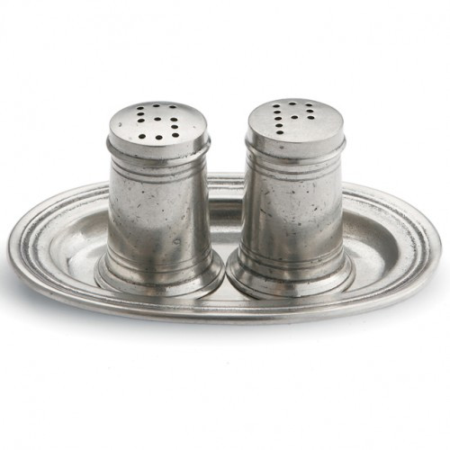 """Serve in style with this refined, hand made salt and pepper set. Italian artisans and the highest quality pewter make these wonderful serving pieces. Italian pewter and glass, Hand made in Italy.  Hand wash only.  Dimensions: 4.75"""" L x 3.25"""" W x 2"""" H SKU: P2670"""