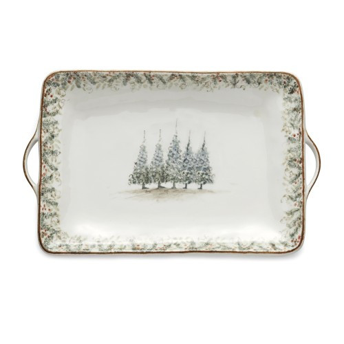 """Natale is the perfect collection to entertain through the winter season. Berries and pine boughs surround the snowy evergreens. Our Natale Large Rectangular Tray has handles for easy serving and boasts five snowy trees in the center, perfect for entertaining. Hand made in Italy.  Microwaveable (may get hot) and dishwasher safe on the low heat, air-dry setting.  Dimensions: 21"""" L X 12.75"""" W X 2.25"""" H SKU: NAT6837"""