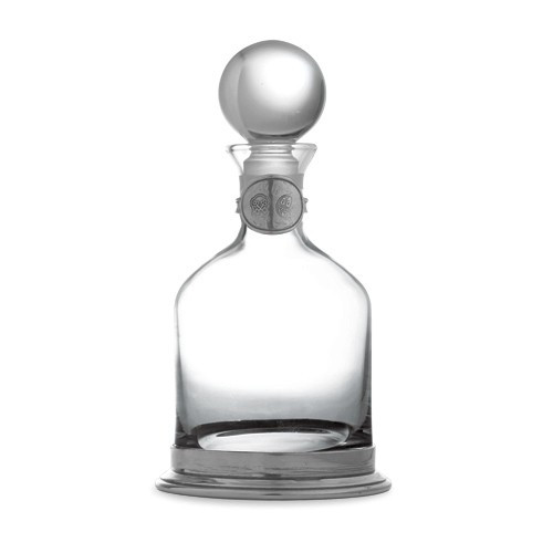 "This elegant decanter will add a distinguished air to any occasion. Monogram the pewter tag to personalize, making it a cherished gift. Italian pewter and glass, Hand made in Italy.  Hand wash only.  Dimensions: 9"" H X 4.25"" D, 20 OZ SKU: P2899"