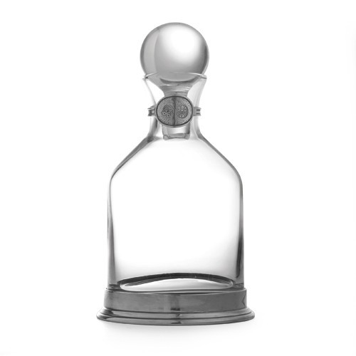 """This elegant decanter will add a distinguished air to any occasion. Monogram the pewter tag to personalize, making it a cherished gift. Italian pewter and glass, Hand made in Italy.  Hand wash only.  Dimensions: 10.5"""" H X 5"""" D, 40 OZ SKU: P2898"""