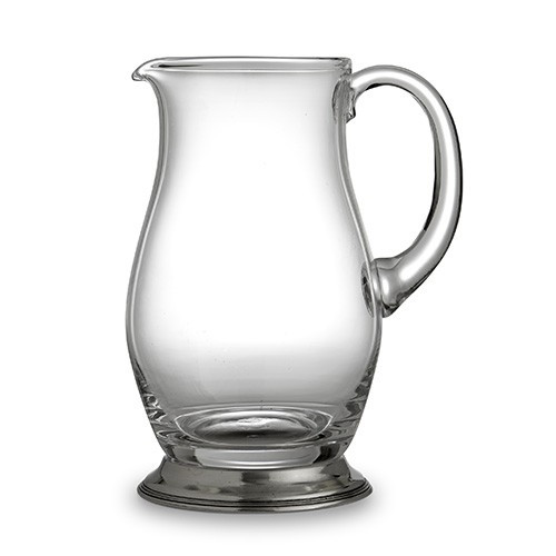 "The Taverna Collection evokes the tradition of meeting friends and family at the local tavern to socialize. Bring that tradition to your home with our new pitcher! Whether using at the bar or for water, juice or tea, the Brussels Pitcher is the perfect piece.! Italian pewter and glass, Hand made in Italy.  Hand wash only.  Dimensions: 4.5""D X 8.75"" H, 51 OZ SKU: P2925"