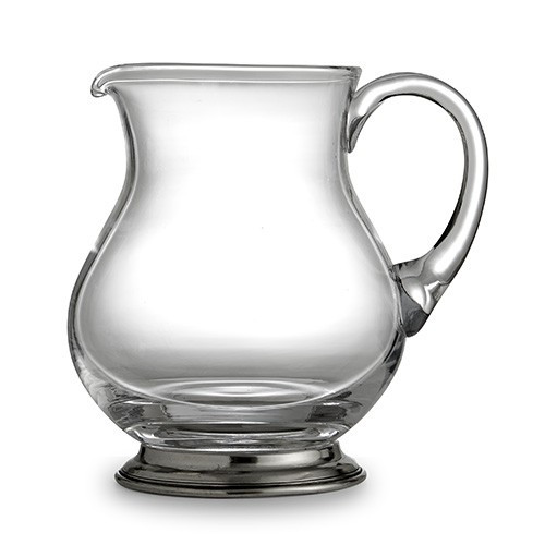 """The Taverna Collection evokes the tradition of meeting friends and family at the local tavern to socialize. Bring that tradition to your home with our new pitcher! Whether using at the bar or for water, juice or tea, the Dublin Pitcher is the perfect piece.! Italian pewter and glass, Hand made in Italy.  Hand wash only.  Dimensions: 5.5"""" D X 7.5"""" H, 56 OZ SKU: P2929"""