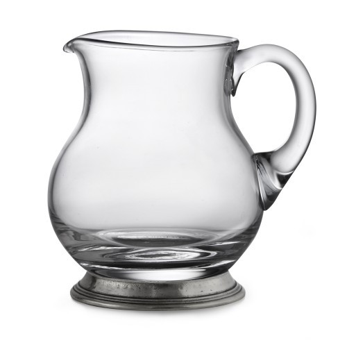 """The Taverna Collection evokes the tradition of meeting friends and family at the local tavern to socialize. Bring that tradition to your home with our new small pitcher! Whether using at the bar or for water, juice or tea, this small Pitcher is the perfect piece.! Italian pewter and glass, Hand made in Italy.  Hand wash only.  Dimensions: 5.25"""" H X 5.5"""" D, 16 OZ SKU: P2943"""