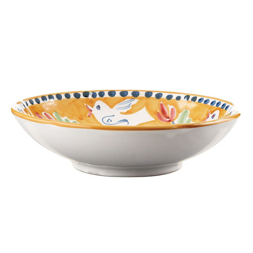 """The colorful orange and blue Uccello Coupe Pasta Bowl features whimsical handpainted birds and flowers and is part of our flagship dinnerware collection, Campagna. Mix with other animals from the Campagna collection to create a fun table that captures the vitality of the Italian countryside! 8.75""""D UCC-1003"""