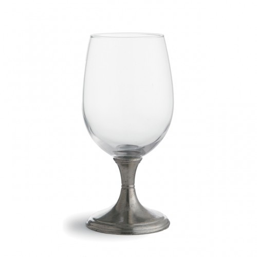 """Graceful forms of glittering crystal are combined with handcrafted pewter stems. This timeless glass adds an elegant feel to any table. Italian pewter and glass, Hand made in Italy.  Hand wash only.  Dimensions: 7.5"""" H X 3"""" D, 20 OZ SKU: P2537"""