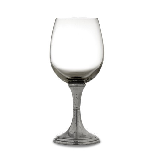 """Graceful forms of glittering crystal are combined with handcrafted pewter stems. This timeless glass adds an elegant feel to any table. Italian pewter and glass, Hand made in Italy.  Hand wash only.  Dimensions: 7.5"""" H X 2.5"""" D 16OZ SKU: P2534A"""