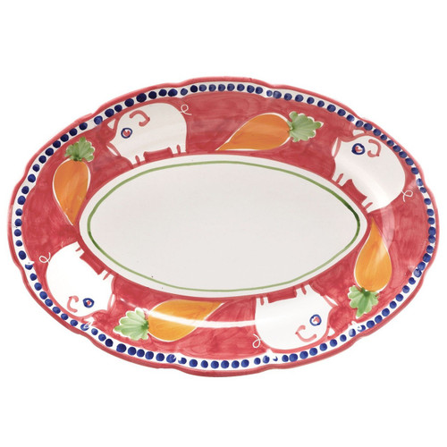 "The colorful Campagna Porco Oval Platter features whimsical handpainted pigs and carrots. 16""L, 11.5""W POR-1022N"