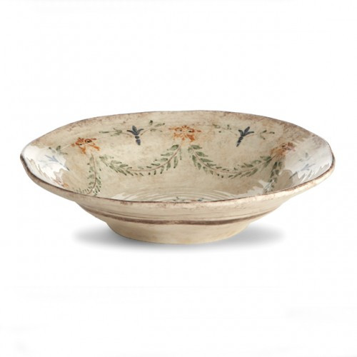 """The gentle cream color of this bowl is accented with a beautiful, hand-painted giglio (fleur-de-lis) and vine motif in rich hues of green, blue and orange. The uneven edges and subtle colors add to the old world look. Italian ceramic, Hand made in Italy.  Microwaveable (may get hot) and dishwasher safe on the low heat, air-dry setting.  Dimensions: 4"""" H x 16.5"""" D SKU: MED2440"""