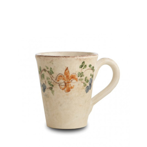 "The gentle cream color of this mug is accented with a beautiful, hand-painted giglio (fleur-de-lis) and vine motif in rich hues of green, blue and orange. The uneven edges and subtle colors add to the old world look. Italian ceramic, Hand made in Italy.  Microwaveable (may get hot) and dishwasher safe on the low heat, air-dry setting.  Dimensions: 4.75""H X 4"" D, 15 OZ SKU: MED2012"
