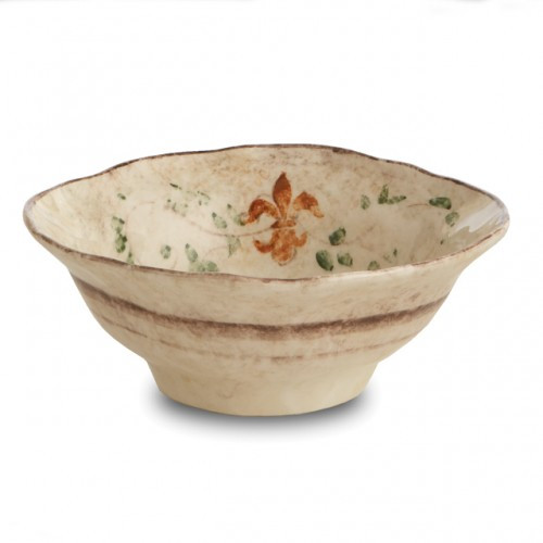 "The gentle cream color of this bowl is accented with a beautiful, hand-painted giglio (fleur-de-lis) and vine motif in rich hues of green, blue and orange. The uneven edges and subtle colors add to the old world look. Italian ceramic, Hand made in Italy.  Microwaveable (may get hot) and dishwasher safe on the low heat, air-dry setting.  Dimensions: 3"" H x 8"" D SKU: MED2120"