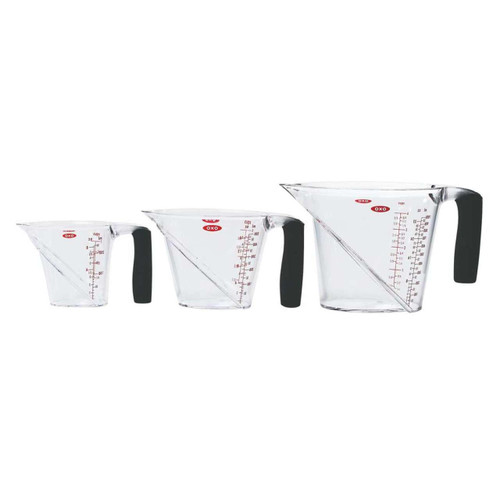 OXO Good Grips 3 Piece Angled Measuring Cup Set  Angled to let you measure accurately from above  The patented angled surface allows you to see measurement markings from above as you're pouring, so you can better measure ingredients without bending or lifting the cup to eye level. Contains markings for cups, ounces, and milliliters. Includes 1-Cup, 2-Cup and 4-Cup Angled Measuring Cups.