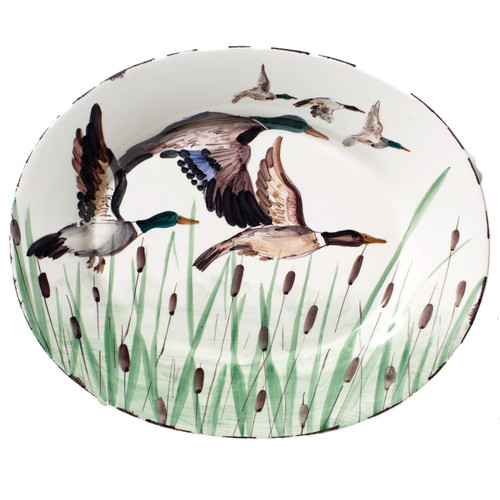 """Serve in style at all of your favorite fall festivities with the Vietri Wildlife Mallard Large Oval Platter. As birds fly south for the winter, this piece looks lovely hung in your dining room or den. 20""""L, 16""""W WDL-7826"""