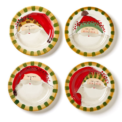 "Vietri Old St Nick Round Salad Plate Set/4  OSN-7802 8.5""D  Embrace the Christmas spirit with the Vietri Old St. Nick Assorted Round Salad Plates from plumpuddingkitchen.com. Perfect for serving a fresh green salad or a light holiday snack, this assortment features whimsical designs inspired by childhood memories of Christmas in Italy."
