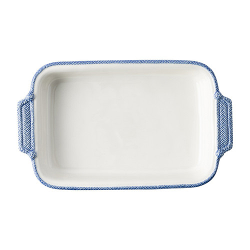 "Le Panier White/Delft Rectangular Baker  № KH18/44 From Julska's Le Panier Collection- The windswept delft blue braided border on this large baking dish is reminiscent of nautical traditions. The pair of pretty handles helps serve up rustic refinement in spades to pair with your legendary cherry lattice slab pie to treat a crowd.   Measurements: 16""L x 9.5""W Capacity: 2.5 quarts Made of Ceramic Stoneware Oven, Microwave, Dishwasher, and Freezer Safe Made in Portugal"
