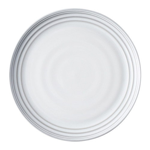 Bilbao White Truffle Dinner Plate  № KC01/17 From Juliska's Bilbao Collection- Hand hewn in a classic coupe shape, this dinner plate from plumpuddingkitchen.com will elevate any casual gathering with a stunning combination of modernity and patina.