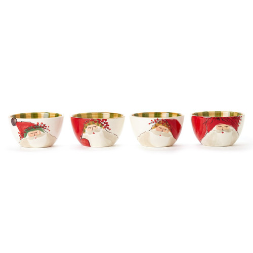 """Embrace the Christmas spirit with the Vietri Old St. Nick Assorted Cereal Bowls. Perfect for serving soups, cereals, and holiday treats, this assortment features whimsical designs inspired by childhood memories of Christmas in Italy. 5.5""""D, 3.25""""H OSN-78051"""