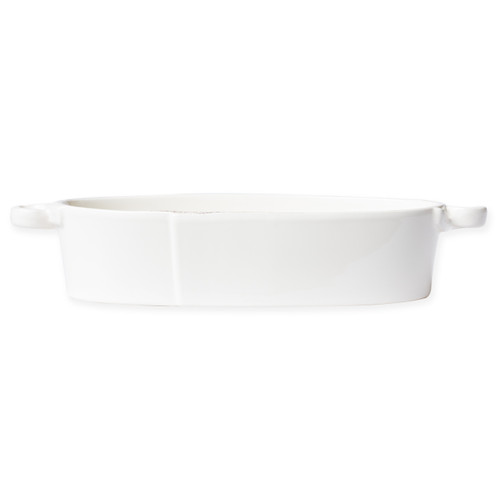 """Vietri Lastra Linen Handled Oval Baker  LAS-2655L 15.5""""L, 5.75""""W, 3""""H  Set your table with the rustic and clean look of Vietri's Lastra Linen dinnerware from plumpuddingkitchen.com. Inspired by an overlapping wooden mold used for centuries to form cheeses throughout Italy and crafted of durable Italian stoneware, this collection is classic and versatile and will be used for years to come."""
