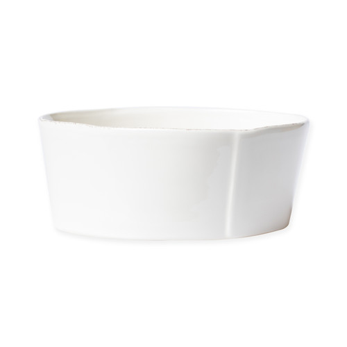 """Vietri Lastra Linen Medium Serving Bowl  LAS-2631L 8.55""""D, 3.5""""H  Set your table with the rustic and clean look of Vietri's Lastra Linen dinnerware from plumpuddingkitchen.com. Inspired by an overlapping wooden mold used for centuries to form cheeses throughout Italy and crafted of durable Italian stoneware, this collection is classic and versatile and will be used for years to come."""