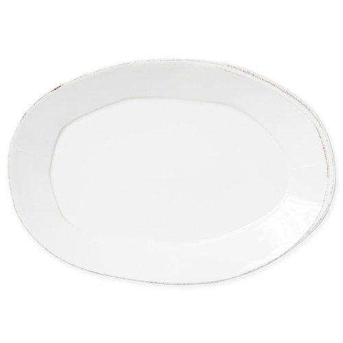 "Vietri Lastra Linen Oval Platter  LAS-2626L 18.5""L, 12.5""W  Set your table with the rustic and clean look of Vietri's Lastra Linen dinnerware from plumpuddingkitchen.com. Inspired by an overlapping wooden mold used for centuries to form cheeses throughout Italy and crafted of durable Italian stoneware, this collection is classic and versatile and will be used for years to come."