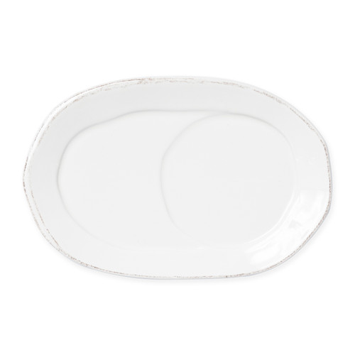 "Vietri Lastra Linen Oval Tray  LAS-2624L 10.25""L, 6.75""W  Set your table with the rustic and clean look of Vietri's Lastra Linen dinnerware from plumpuddingkitchen.com. Inspired by an overlapping wooden mold used for centuries to form cheeses throughout Italy and crafted of durable Italian stoneware, this collection is classic and versatile and will be used for years to come."