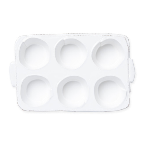 "Vietri Lastra White Muffin Tin  LAS-2688W 12.25""L, 7.5""W  Set your table with the rustic and clean look of Vietri's Lastra Linen dinnerware from plumpuddingkitchen.com. Inspired by an overlapping wooden mold used for centuries to form cheeses throughout Italy and crafted of durable Italian stoneware, this collection is classic and versatile and will be used for years to come."
