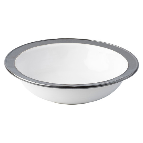 "Emerson White/Pewter 13"" Serving Bowl  KP28/92 13""D, 3.5""H, 3Qt  From Juliska's Emerson Collection - Our handsome and infinitely versatile Emerson pieces from plumpuddingkitchen.com are rimmed in our burnished Pewter hue. Stunning mixed into any table setting for a bit of shine, be it a romantic Summer tea amid the roses or a sparkling candlelit soiree.  Made of ceramic stoneware in Portugal.  Oven, microwave, dishwasher and freezer safe."