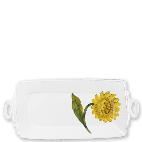 "Lastra Sunflower Rectangular Platter  LSF-2623 16""L, 8.75""W The simple sophistication of Vietri's Lastra endures with Lastra Sunflower from plumpuddingkitchen.com. Bringing the joy of Italian girasole (sunflower) to your table, this collection features bright yellow and vibrant greens, detailing the beauty of this handpainted collection.  Handpainted on Italian stoneware in Tuscany. Dishwasher, microwave, freezer and oven safe."
