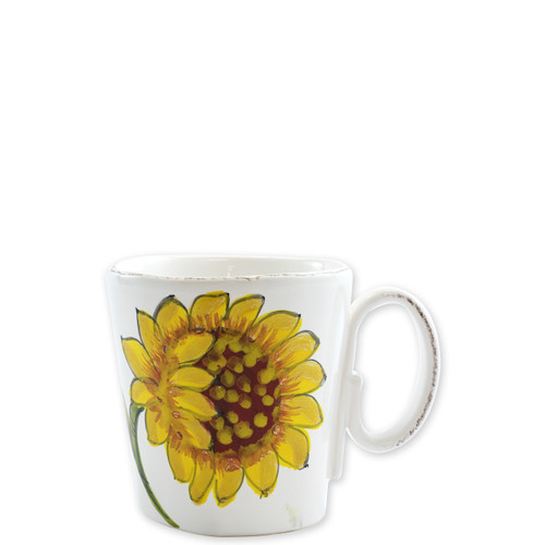 "Lastra Sunflower Mug  LSF-2610 4""H, 12oz  The simple sophistication of Vietri's Lastra endures with Lastra Sunflower from plumpuddingkitchen.com. Bringing the joy of Italian girasole (sunflower) to your table, this collection features bright yellow and vibrant greens, detailing the beauty of this handpainted collection.  Handpainted on Italian stoneware in Tuscany. Dishwasher, microwave, freezer and oven safe."