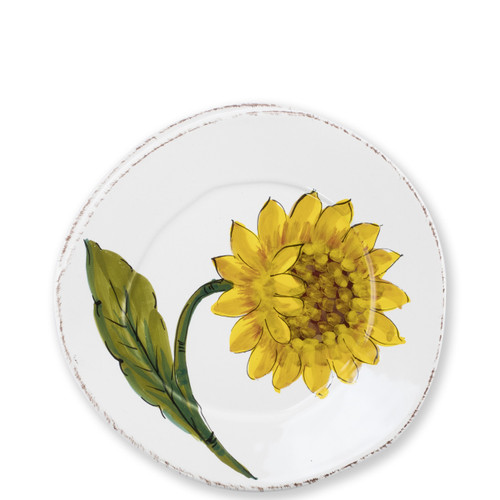 """Lastra Sunflower Salad Plate  LSF-2601 8.75""""D  The simple sophistication of Vietri's Lastra endures with Lastra Sunflower from plumpuddingkitchen.com. Bringing the joy of Italian girasole (sunflower) to your table, this collection features bright yellow and vibrant greens, detailing the beauty of this handpainted collection.  Handpainted on Italian stoneware in Tuscany. Dishwasher, microwave, freezer and oven safe."""