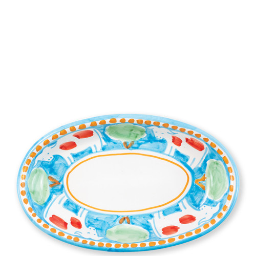 "Vietri Campagna Mucca Small Oval Tray  MCA-1040 10""L, 6.5""W  Part of Vietri's premiere dinnerware line from the famed Amalfi Coast, Mucca from plumpuddingkitchen.com offers endless possibilities for artistic entertaining when mixed with bright solids or the other colorful patterns of Campagna. Capture the vitality of the Italian countryside with this whimsical collection!  Translation: cow Handmade of terra cotta in Campania by Solimene Part of the Campagna Collection, VIETRI's very first dinnerware collection introduced in 1983! Dishwasher and microwave safe"