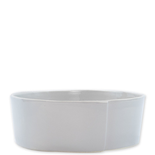 """Vietri Lastra Light Gray Large Serving Bowl  LAS-2632LG 10.75""""D, 4""""H   The Lastra Light Gray Large Serving Bowl from plumpuddingkitchen.com brings rustic elegance to your home. An overlapping wooden mold, used for centuries to form cheeses throughout Italy, inspired this collection."""
