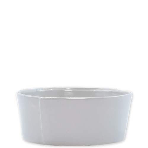 """Vietri Lastra Light Gray Medium Serving Bowl  LAS-2631LG 8.5""""D,  3.5""""H   The Lastra Light Gray Medium Serving Bowl from plumpuddingkitchen.com brings rustic elegance to your home. An overlapping wooden mold, used for centuries to form cheeses throughout Italy, inspired this collection."""