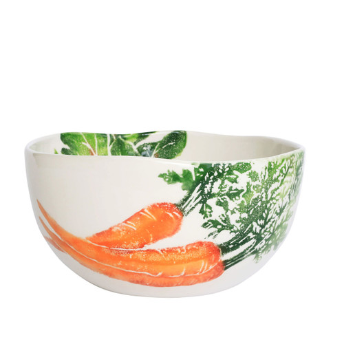 """Vietri Spring Vegetables Deep Serving Bowl  SVG-9733 9.5""""D, 5""""H  SPRING VEGETABLES Handpainted by maestro artisan, Gianluca Fabbro, using a unique sponging technique, an adorable hare and fresh vegetables depict a vibrant picture of spring.  A colorful mix of spring garden classics from plumpuddingkitchen.com come to life in an assortment of eating pieces and serving accessories in this beautiful collection.  Handpainted on terra bianca in Veneto. Dishwasher and microwave safe."""
