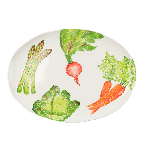 "Vietri Spring Vegetables Large Oval Platter  SVG-9726 21.75""L, 15.5""W  SPRING VEGETABLES Handpainted by maestro artisan, Gianluca Fabbro, using a unique sponging technique, an adorable hare and fresh vegetables depict a vibrant picture of spring.  A colorful mix of spring garden classics from plumpuddingkitchen.com come to life in an assortment of eating pieces and serving accessories in this beautiful collection.  Handpainted on terra bianca in Veneto. Dishwasher and microwave safe."
