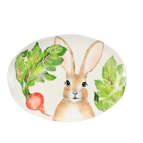 "Vietri Spring Vegetables Medium Oval Platter  SVG-9725 17""L, 12.5""W  SPRING VEGETABLES Handpainted by maestro artisan, Gianluca Fabbro, using a unique sponging technique, an adorable hare and fresh vegetables depict a vibrant picture of spring.  A colorful mix of spring garden classics from plumpuddingkitchen.com come to life in an assortment of eating pieces and serving accessories in this beautiful collection.  Handpainted on terra bianca in Veneto. Dishwasher and microwave safe."