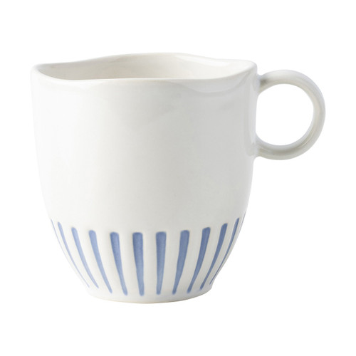 "Sitio Stripe Indigo Mug  KW46/046  From our Wanderlust Collection - Equally stunning and simplistic, radiant stripes in breezy shades of blue adorn this dinnerware collection. This mug adds a bit of exoticism to your morning routine.  Measurements: 5""L, 3.75""W, 4""H Capacity: 12 ounces Made of Ceramic Stoneware Made in Portugal"