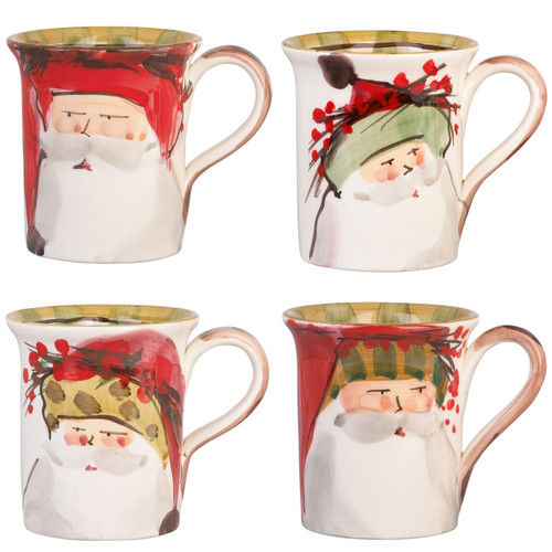 "Vietri Old St Nick Mug Set/4  OSN-7810 4.5""H, 14oz Vietri Old St Nick Mugs from plumpuddingkitchen.com are handmade of terra bianca (white clay) in Tuscany. Four jolly santas are handpainted on this assorted set of mugs. Perfect for drinking hot chocolate on a cold winter night!"