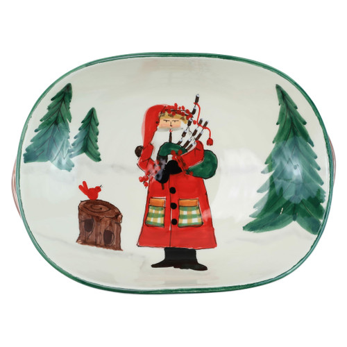 """Vietri Old St Nick Handled Shallow Oval Bowl - Santa w/ Bagpipes OSN-78081  """"Inspired by childhood memories of Babbo Natale, Italy's Santa Claus, maestro artisans handpaint the Old St. Nick Handled Shallow Oval Bowl - Santa w/ Bagpipes, providing us a glimpse into Old St. Nick's daily adventures leading up to preparations for each holiday season. 
