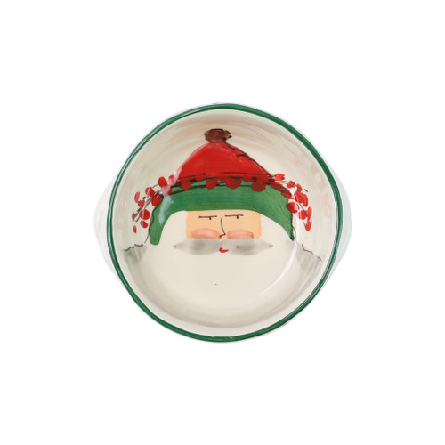 """Vietri Old St NickSmall Handled Round Baker  OSN-78074  """"The Old St. Nick Small Handled Round Baker from plumpuddingkitchen.com features the handpainted designs of maestro artisan Alessandro Taddei. Alessandro relays the stories of Babbo Natale through his whimsical designs, providing us a glimpse into Old St. Nick's daily adventures leading up to preparations for each holiday season.   Care: Dishwasher and Oven Safe   Material: Terra Bianca Earthenware   Measurement: 6.5""""""""D, 2.5""""""""H"""""""