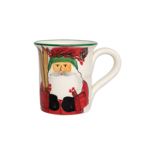 """Vietri Old St Nick Mug - Skiing  OSN-78088  """"Inspired by childhood memories of Babbo Natale, Italy's Santa Claus, maestro artisans handpaint the Old St. Nick Mug - Skiing from plumpuddingkitchen.com, providing us a glimpse into Old St. Nick's daily adventures leading up to preparations for each holiday season. 