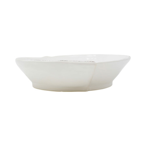 "Vietri Lastra White MediumShallow Serving Bowl  LAS-26025W  Perfect for serving and/or baking, the Lastra White Medium Shallow Serving Bowl is simple, sophisticated, and chic. Handcrafted of Italian stoneware in Tuscany, the Lastra collection folds in perfectly to any eating or serving assortment. | Care: Dishwasher, Microwave, Oven, Freezer Safe | Material: Italian Stoneware | Measurement: 10""""D, 2.5""""H"""
