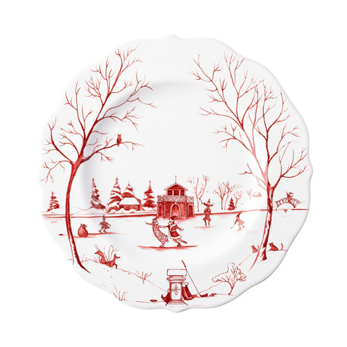 """Juliska Country Estate Winter Frolic """"The Claus' Christmas Day"""" Ruby Dessert/Salad Plate CE02X/73 9""""D  Juliska's charming English Country Estate is snow covered for the holidays! In this latest chapter of the estate at Christmastime, Santa & Merry celebrate with all the North Pole inhabitants. This subtly scalloped dessert/salad plate from plumpuddingkitchen.com features 'The Claus' Christmas Day"""" including Santa & Merry ice skating on the pond outside the Boathouse."""