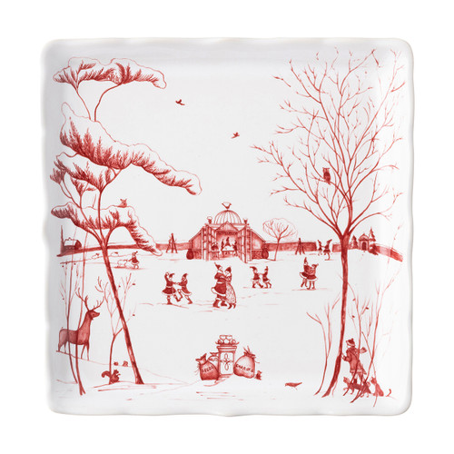 """Juliska Country Estate Winter Frolic """"Mr. & Mrs. Claus"""" Ruby Sweets Tray CE95/73 8""""D  Juliska's charming English Country Estate is snow covered for the holidays! In this latest chapter of the estate at Christmastime, Santa & Merry celebrate with all the North Pole inhabitants. This square sweets tray  features an illustration of the Claus' and elves dancing together outside the Conservatory."""