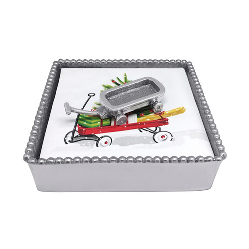 Mariposa Wagon Beaded Napkin Box  4268-C 5.75in L x 5.75in W x 1.5in H Bring out your inner child this holiday season with our delightful Wagon Beaded Napkin Box! Make holiday entertaining even more joyful with this charming piece. Handcrafted from 100% recycled aluminum. Recycled Sandcast Aluminum