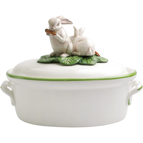 "Vietri Spring Vegetables Tureen with Bunnies  SVG-1779 13""L, 8.25""W, 9.25""H  SPRING VEGETABLES Handpainted by maestro artisan, Gianluca Fabbro, using a unique sponging technique, an adorable hare and fresh vegetables depict a vibrant picture of spring.  A colorful mix of spring garden classics from plumpuddingkitchen.com come to life in an assortment of eating pieces and serving accessories in this beautiful collection.  Handpainted on terra bianca in Veneto. Dishwasher and microwave safe."