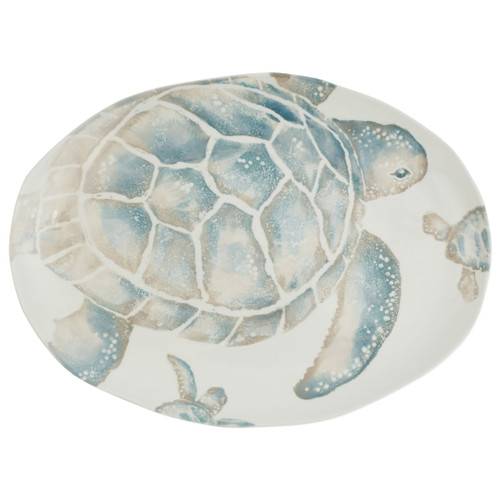 "Vietri Tartaruga Medium Oval Platter  TAR-9737 17.5""L, 13.25""W  Maestro artisan, Gianluca Fabbro, uses a unique sponging technique on Tartaruga, blending soft hues of the sea and sand to illustrate the story of baby sea turtles leaving their nest for the first time.  Handpainted on terra bianca in Veneto.  Dishwasher and microwave safe."