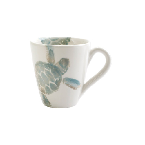 "Vietri Tartaruga Mug  TAR-9710 4.25""H, 14oz  Maestro artisan, Gianluca Fabbro, uses a unique sponging technique on Tartaruga, blending soft hues of the sea and sand to illustrate the story of baby sea turtles leaving their nest for the first time.  Handpainted on terra bianca in Veneto.  Dishwasher and microwave safe."