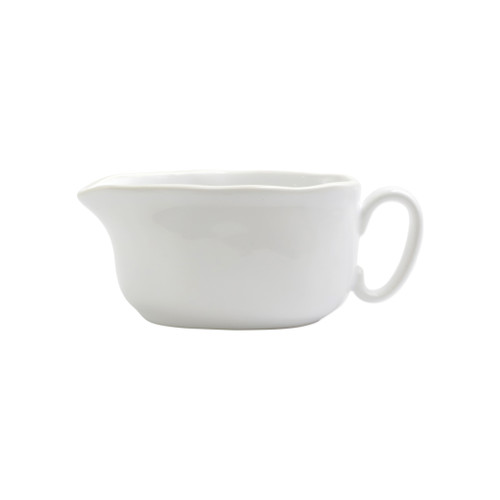 """Vietri Viva Chroma White Gravy Boat  VCRM-W003043 7.5""""L, 3.5""""W, 3""""H  Simple lines, clean design.  Vietri's Chroma is defined by its purity of color and smooth shapes making it the perfect backdrop for your monthly dinner parties or casual nights in with the family.  Handpainted on hard ceramic in Portugal.  Dishwasher & Microwave safe."""