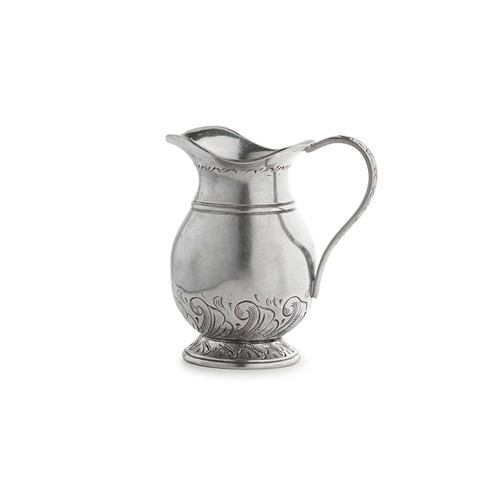 "Arte Italica Peltro Petite Pitcher PEL6720  Peltro, meaning pewter in Italian, exemplifies the beauty of handcrafted pewter. Each piece is made with extreme care and detail and you will find hallmarks, stamps and 95 proving it is 95% tin, the highest grade pewter made! This petite pitcher is adorable and the perfect little piece to hold some hand picked wild flowers. Italian pewter, Hand made in Italy. Wipe clean with a damp cloth.  4"" L x 2.5"" W x 3.75"" H"